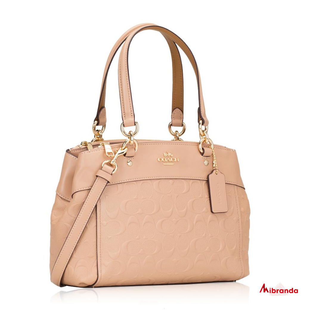 Bolso mini BROKE, de Coach, color nude.