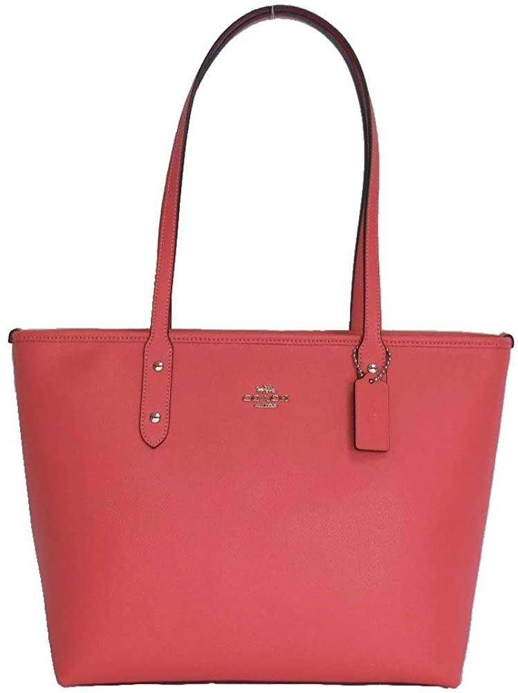 Bolso Tote CITY, de Coach, color coral.