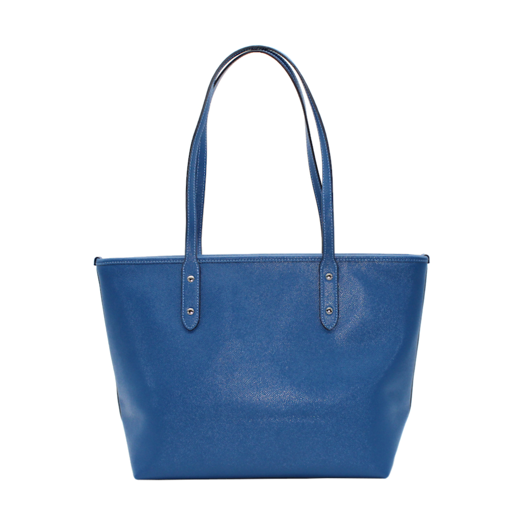 Bolso Tote, de Coach, color azul metalizado.
