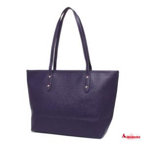 Bolso Tote City, de Coach, color púrpura.