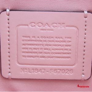 Bolso Tote Surrey, de Coach, en estampado y rosa