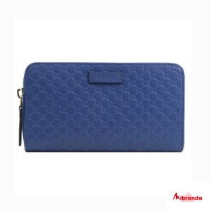 Gucci cartera con cremallera GG microguccíssima, en piel azul.