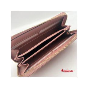 Gucci cartera con cremallera GG microguccíssima, en piel rosa.