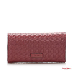 Gucci cartera con solapa GG microguccíssima, piel roja,