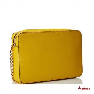 Bandolera JET SET, de Michael Kors, color amarillo.